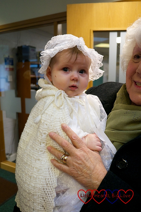 Sophie in my christening gown and bonnet and her daddy's christening shawl