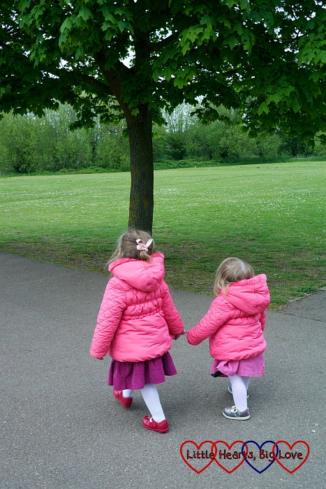Two little girls walking hand in hand at Rickmansworth Aquadrome - Little Hearts, Big Love