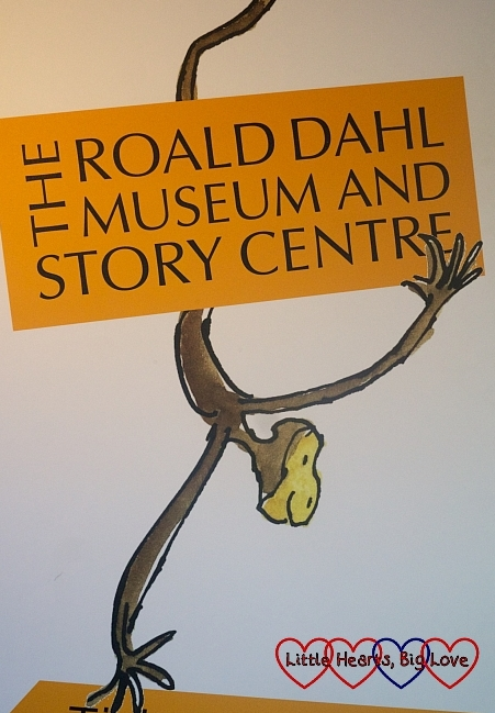 "A illustration of a monkey with a sign saying ""The Roald Dahl Museum and Story Centre"""