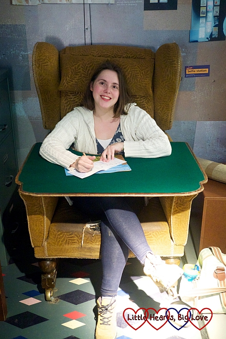 Me sitting in a replica of Roald Dahl's writing chair