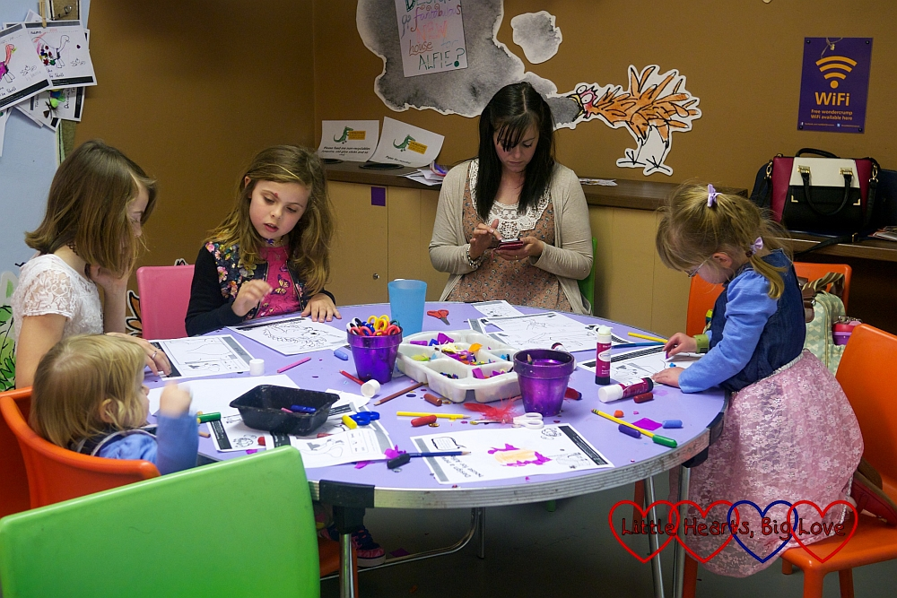 My twin sister and the four girls sitting down and getting creative in George's Crafty Kitchen