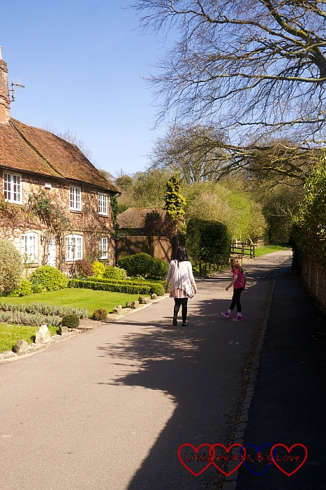 My sister and niece walking past some cottages