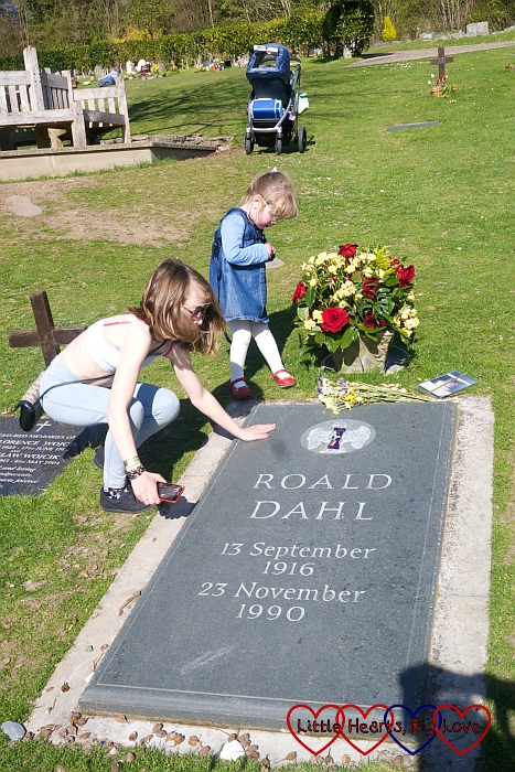 Ebony and Jessica looking at Roald Dahl's grave