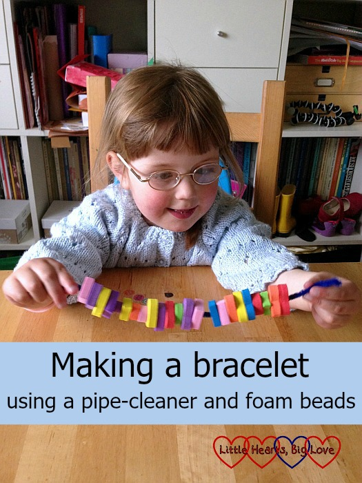 Making a bracelet using a pipe-cleaner and foam beads - a fabulous activity for toddlers and preschools to help with fine motor skills, counting skills and shape and colour recognition - Little Hearts, Big Love
