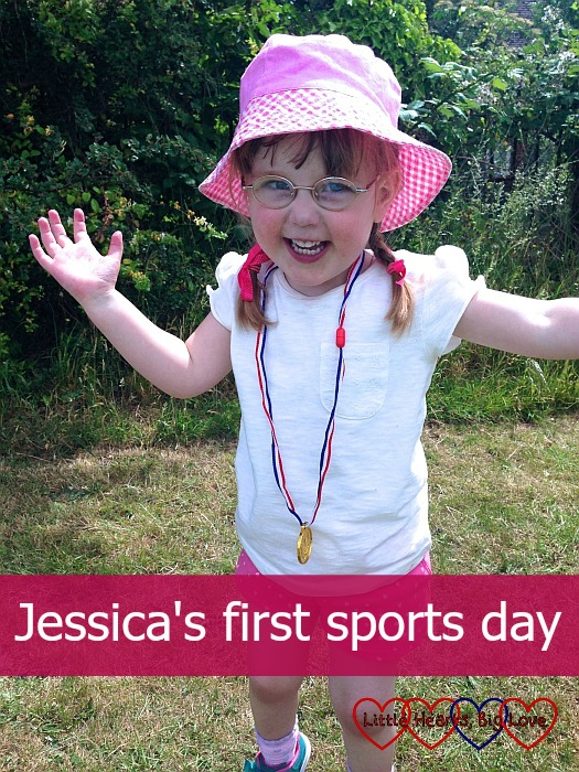 """A proud little girl with her winner's medal - """"Jessica's first sports day"""""""