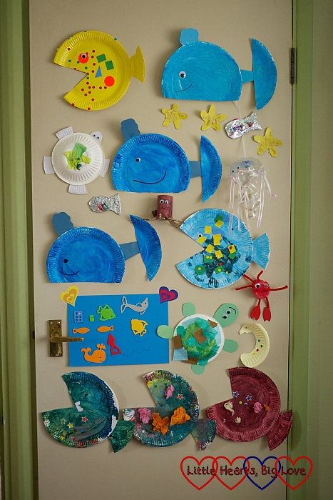 Our dining room door with all our sea-themed creatures stuck to it.