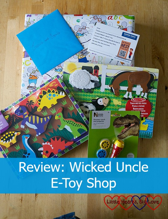 "A wrapped present and a selection of toys from the Wicked Uncle site - ""Review: Wicked Uncle E-Toy Shop"""