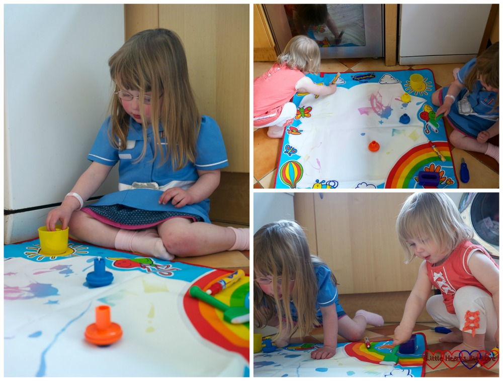 Jessica and Sophie painting on the Aquadoodle mat
