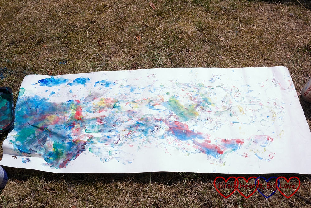 A piece of lining paper covered in colourful footprints