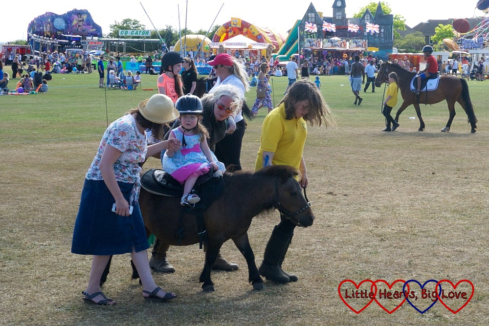 First pony ride at Party in the Park  - Little Hearts, Big Love