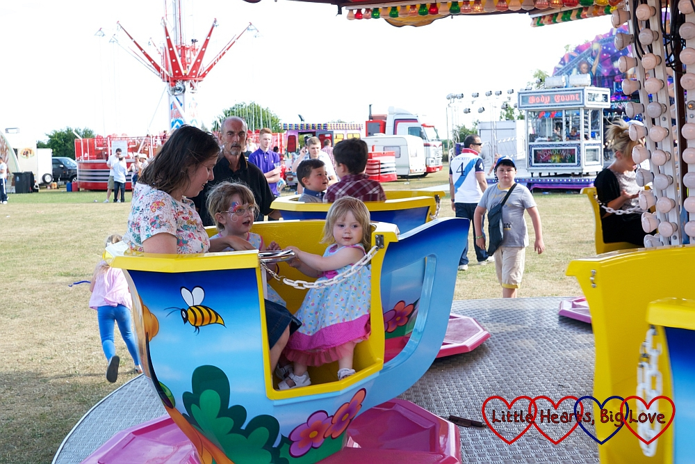 A ride in the spinning teacups at Party in the Park  - Little Hearts, Big Love