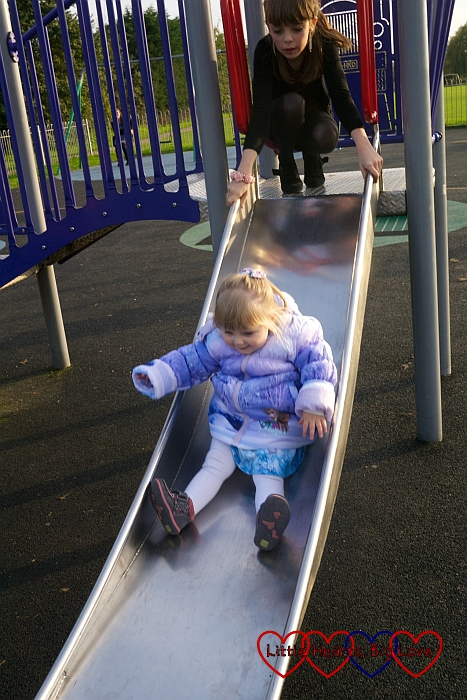 Going down the slide - Birthday fun at the park - Little Hearts, Big Love