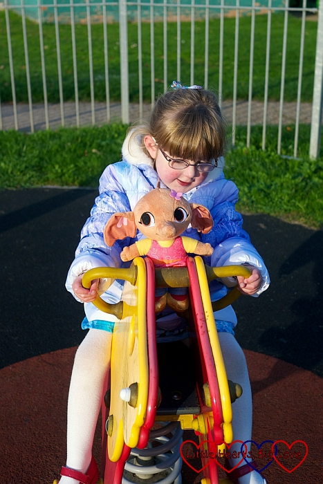 Sula enjoys the rocking horse - Birthday fun at the park - Little Hearts, Big Love