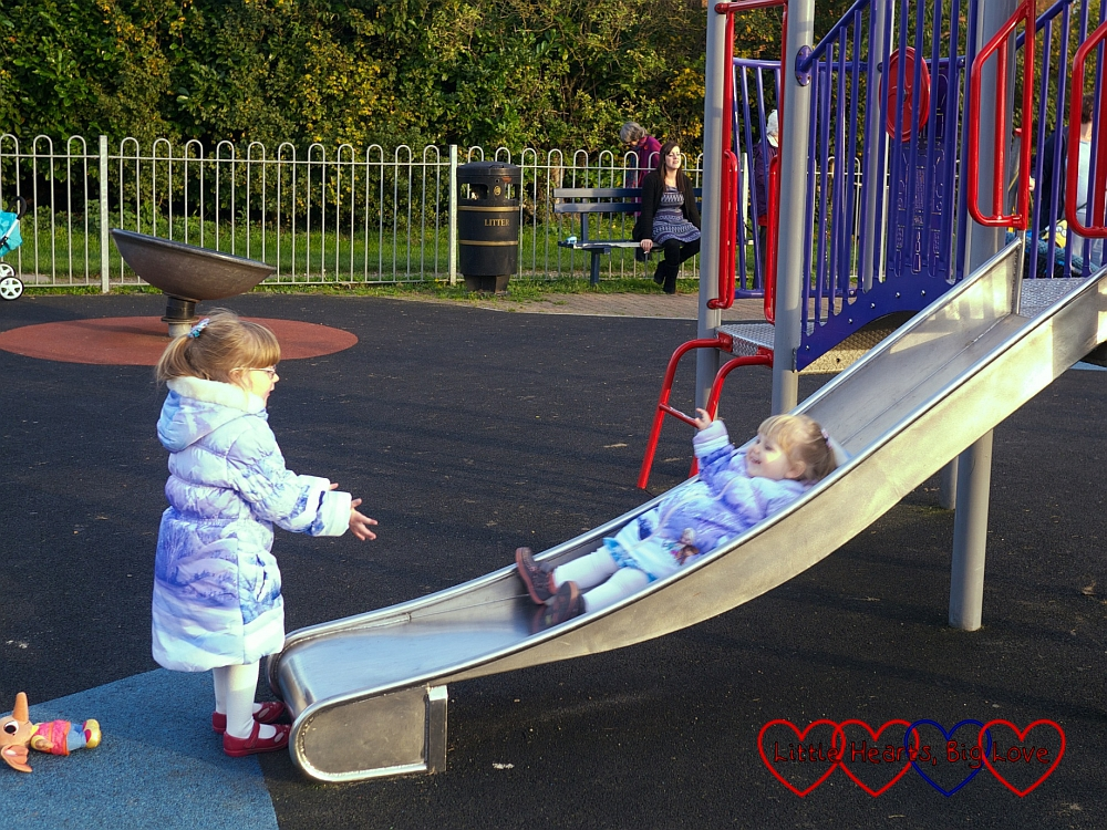 Catching Sophie on the slide - Birthday fun at the park - Little Hearts, Big Love