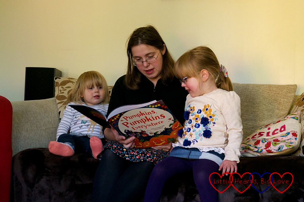 Sitting together and reading Pumpkins, Pumpkins Everywhere - Little Hearts, Big Love