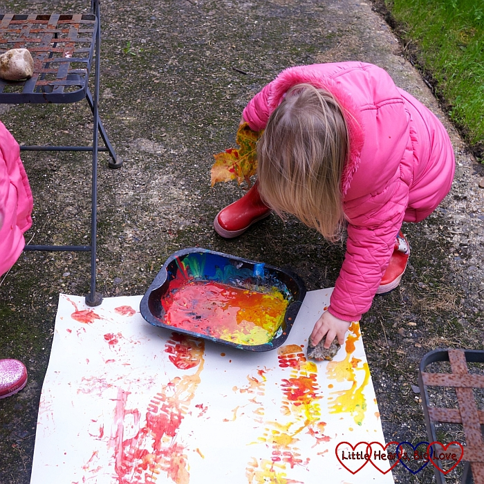 Sophie paint printing with rocks