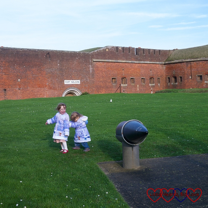 Jessica and Sophie exploring outside Fort Nelson