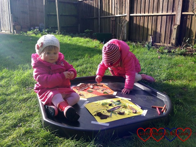 Sophie and Jessica creating a nature collage in the garden