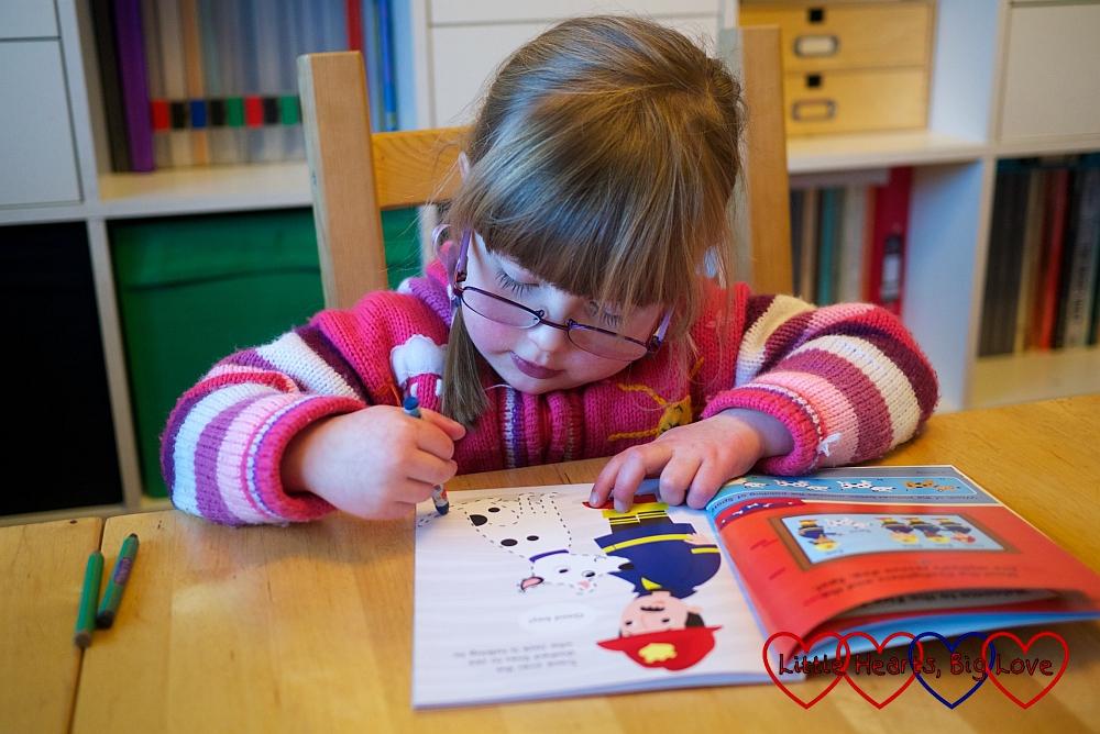 Jessica enjoying the fire station activity book - Review - Fire Station Activity Book and Playset from Parragon Books - Little Hearts, Big Love