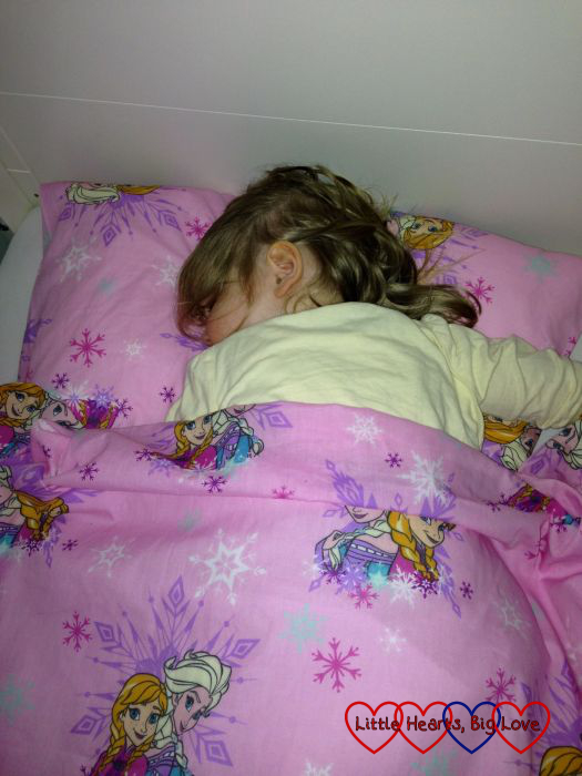Sophie alseep in her bed with her new Frozen duvet and pillow