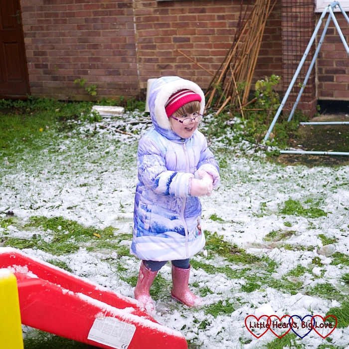 A very happy Jessica making snowballs