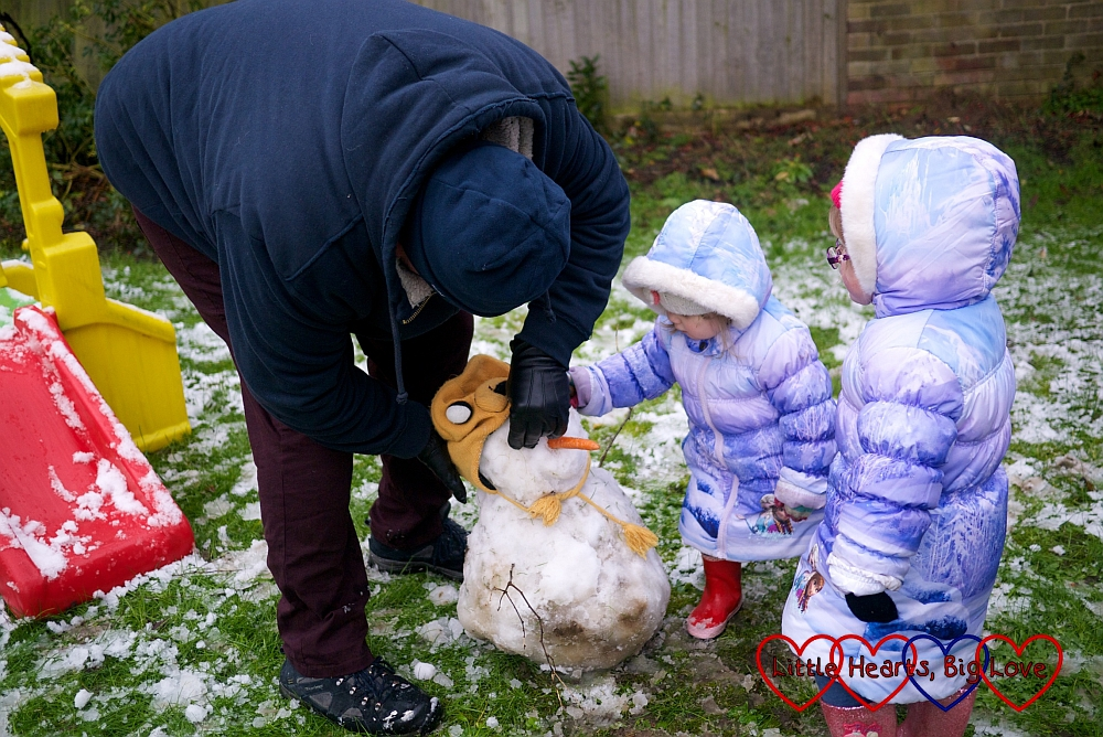 Hubby, Sophie and Jessica making a snowman