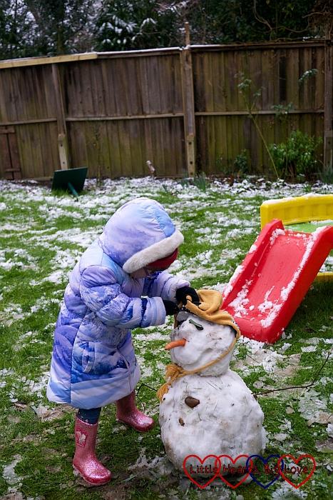 Jessica making a snowman
