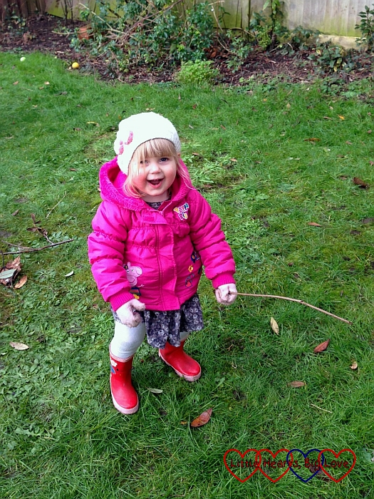 Sophie using a stick as a fishing rod