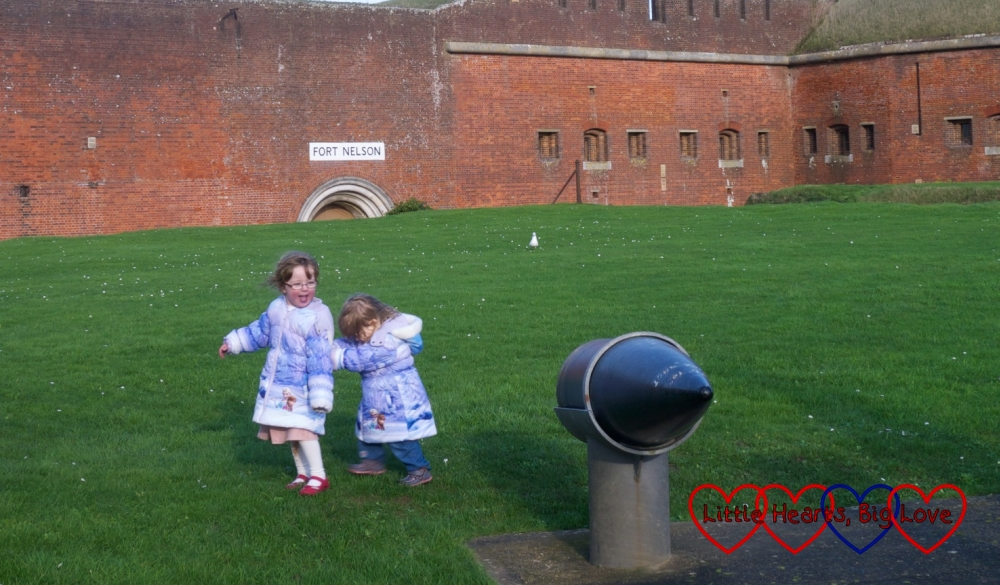 Jessica and Sophie exploring the outside of Fort Nelson