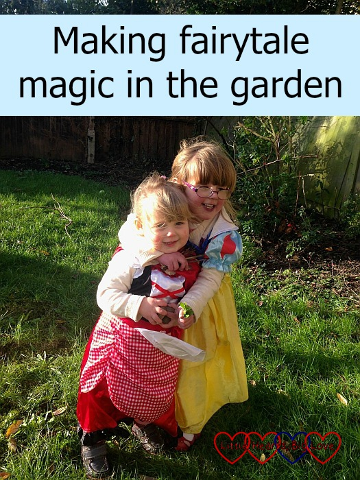 "Sophie in a Red Riding Hood outfit with Jessica in a Snow White dress hugging her - ""Making fairytale magic in the garden"""