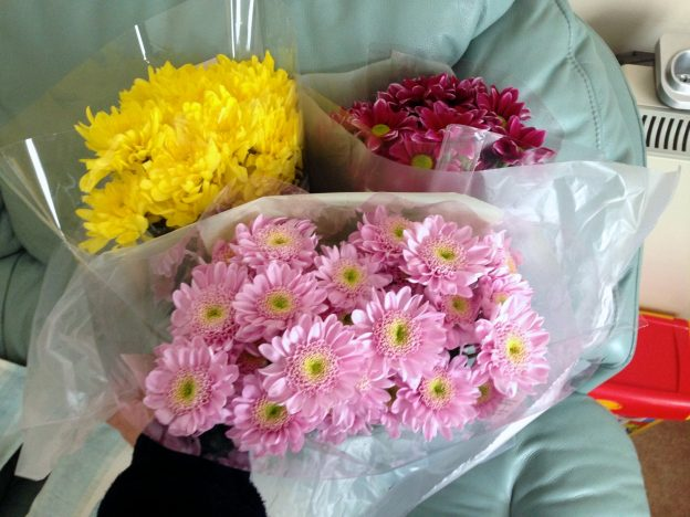 Three bouquets of flowers ready to be handed out as part of 40acts