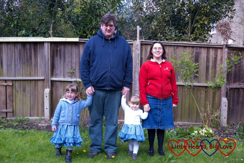 The four of us together having a family moment in the garden for this month's Me and Mine project