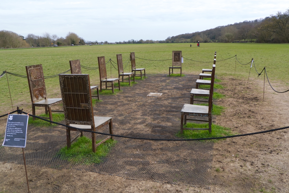 The twelve bronze chairs which make up The Jurors