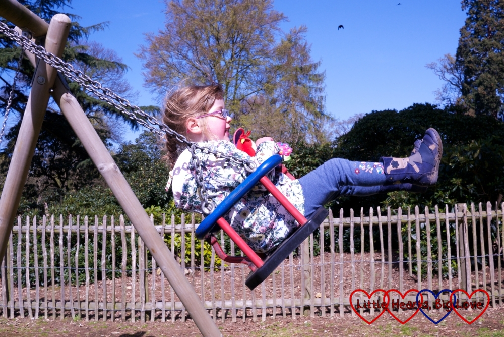 Going really high on the swings at Langley Park