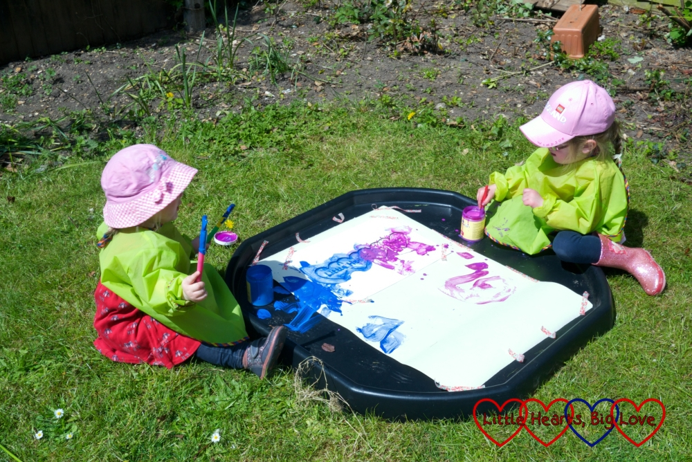 Painting in the back garden with the girls