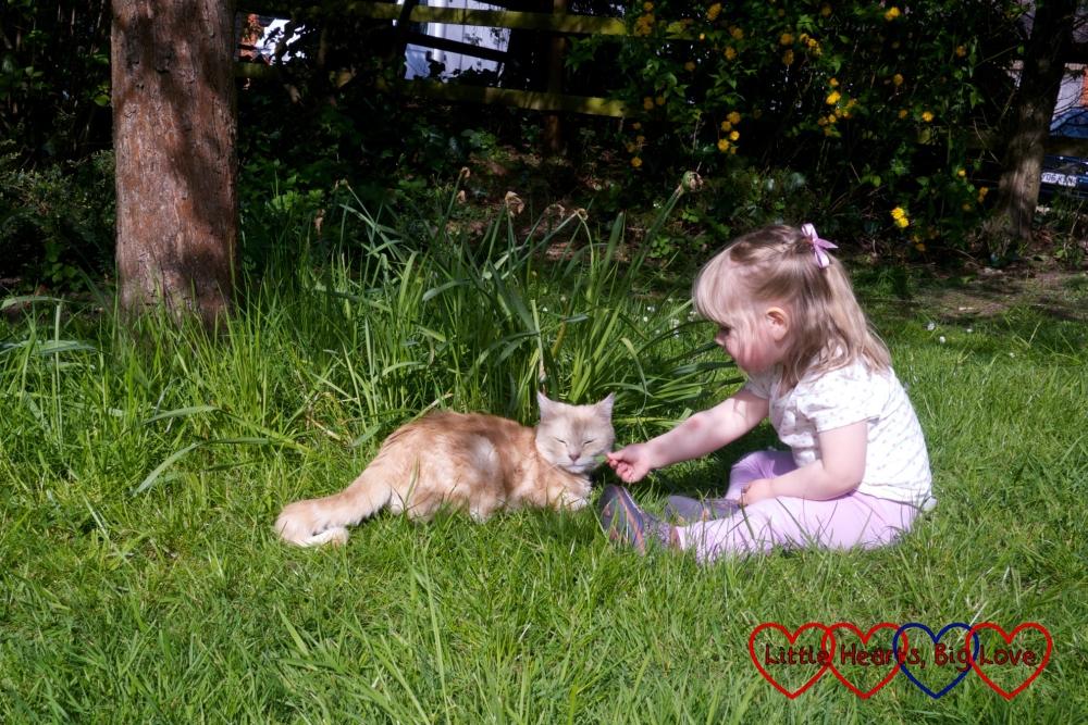 Sophie sitting with Saffron (the cat)