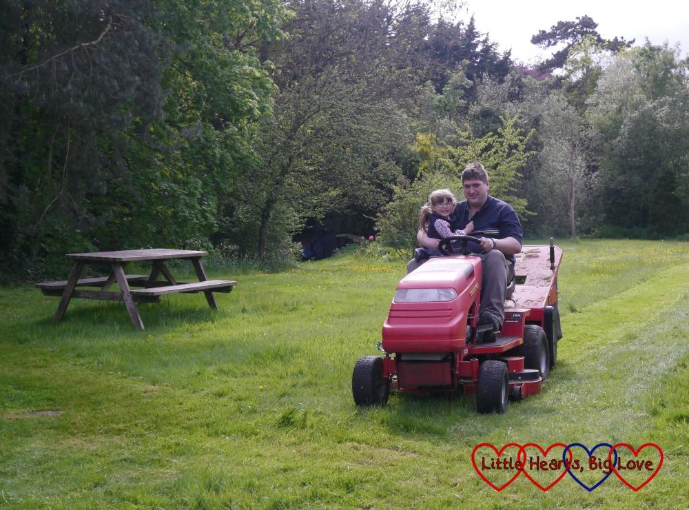 Jessica helping Daddy mow the lawn on Grandad's big ride-on lawnmower