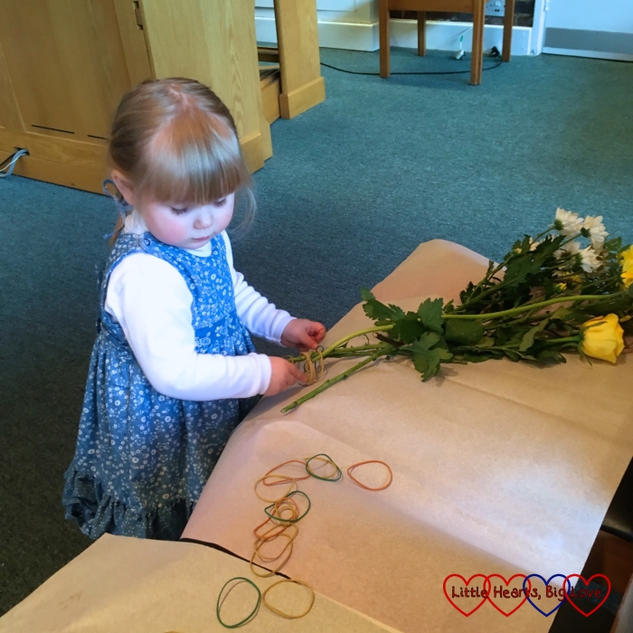 Sophie helping distribute the flowers after church