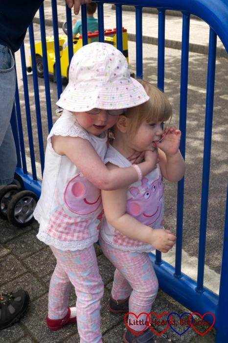 Jessica giving her little sister a cuddle at Legoland