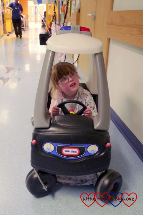 Riding the Little Tikes cars up and down the ward