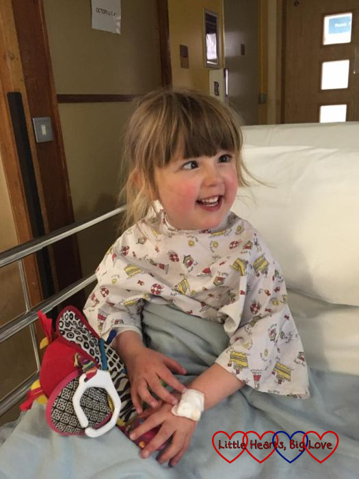 """A happy girl taking a ride in a """"carriage"""" and heading off to the cath lab"""