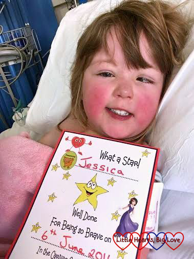 My brave little girl with her certificate after her cardiac catheter procedure