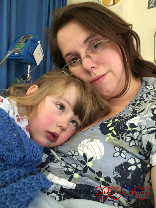 Jessica having snuggles with Mummy after her cardiac catheter procedure