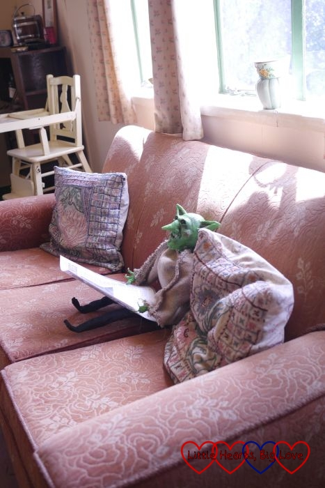A goblin reading the Radio Times in the Amersham Prefab at Chiltern Open Air Museum