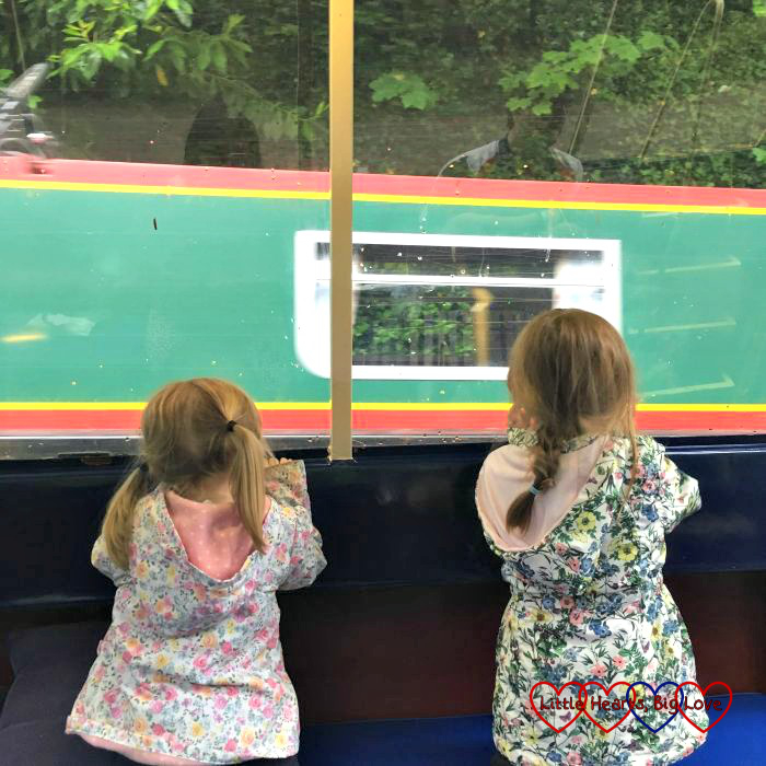 Jessica and Sophie enjoying their first ride on a narrowboat