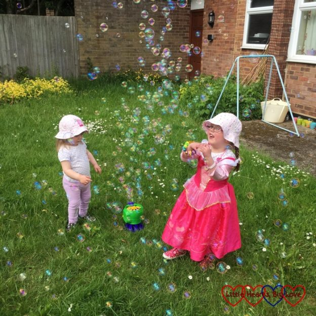 Having fun playing with bubbles in the garden