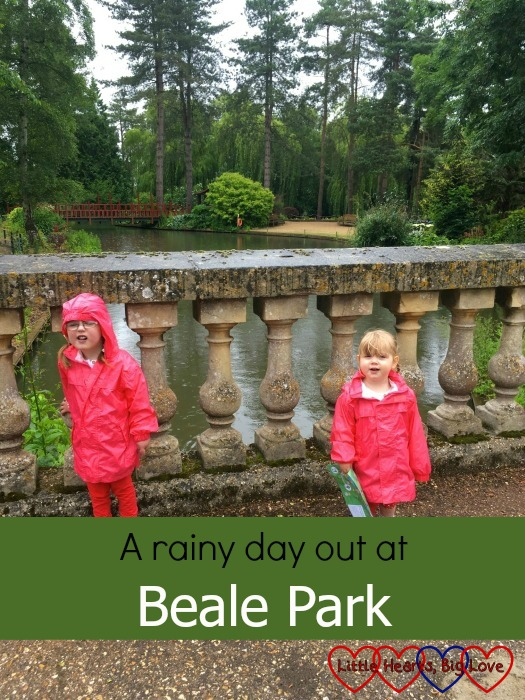 Jessica and Sophie standing on a bridge on a rainy day at Beale Park