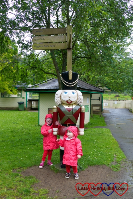 """Jessica and Sophie posing with a sculpture of a wooden soldier that they decided was """"The Grand Old Duke of York"""""""
