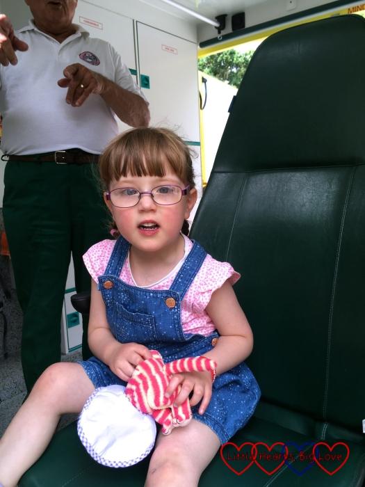 Jessica sitting in the PICU retrieval ambulance