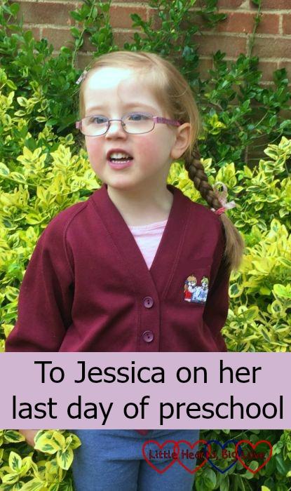 Jessica in her preschool cardigan standing outside in the garden ready for her last week at preschool